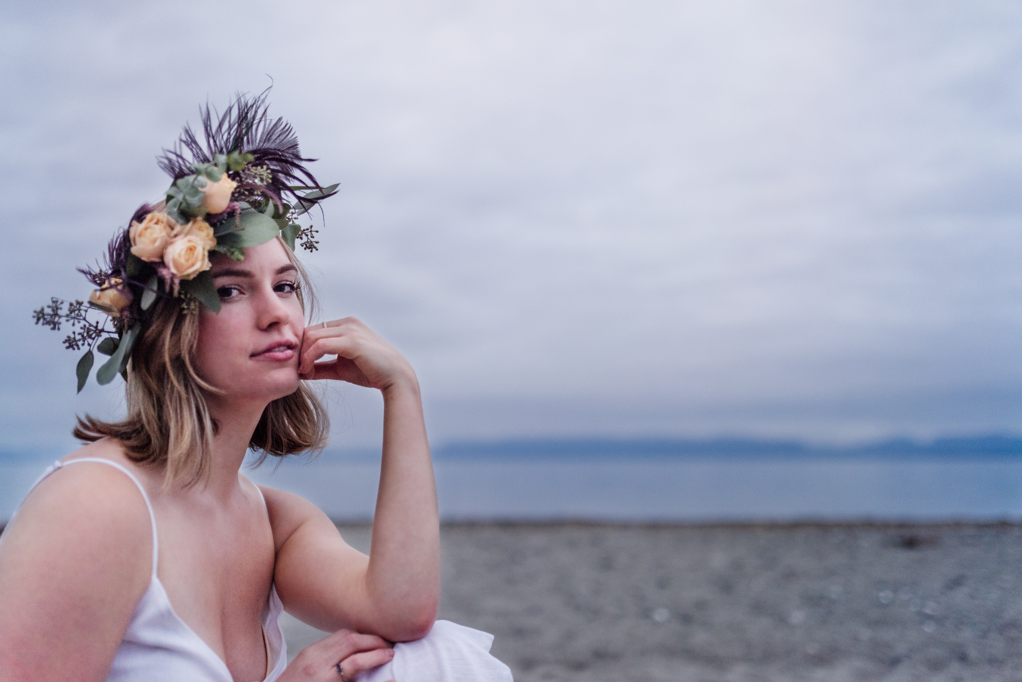 Woman at beach wearing flower crown for lifestyle photoshoot