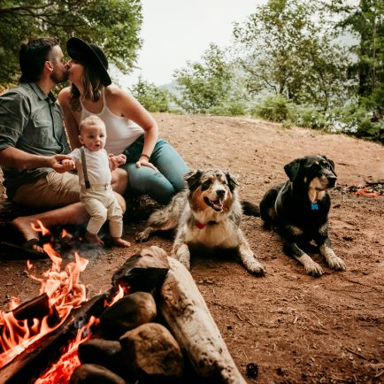 Family by the campfire with dogs at the lake for lifestyle family photoshoot